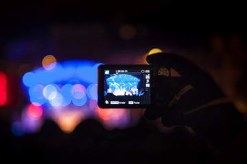 Taking video with smartphone during a public concert