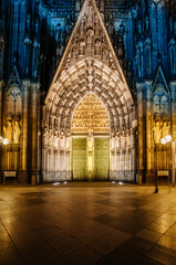 Cologne door entrance cathedral facade at night