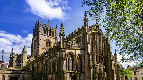 Gothic church exterior on a sunny day blue sky time lapse