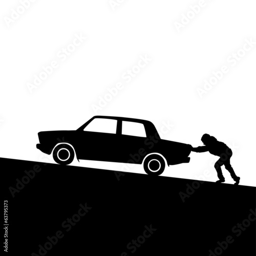 Silhouette of man pushing a car