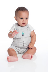Portrait of a Baby Boy Wearing Overalls with Sailboat Decal