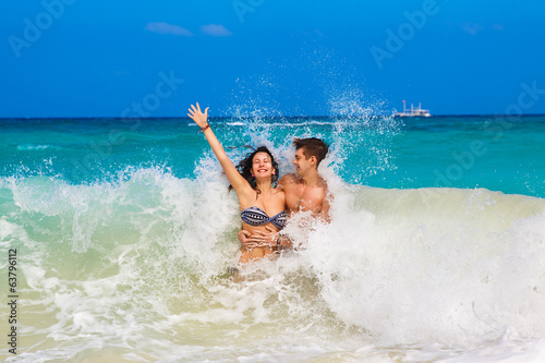 young loving happy  couple on tropical beach,