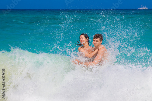 young loving happy  couple on tropical beach