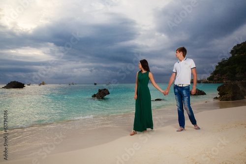 young loving couple on tropical beach