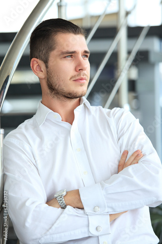 happy young business man in modern office