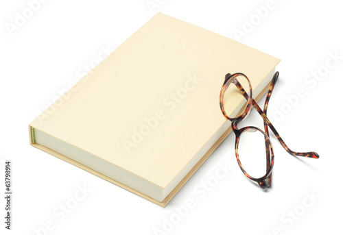 Hardcover Book and Reading Glasses