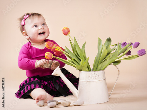 Little smiling girl with tulips