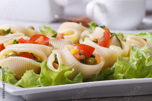Salad of fresh vegetables inside lumakoni pasta