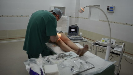 Surgeon operating patient leg. general view of the operating