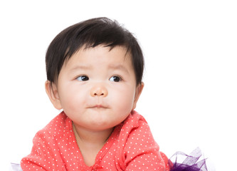 Asian baby girl looking aside