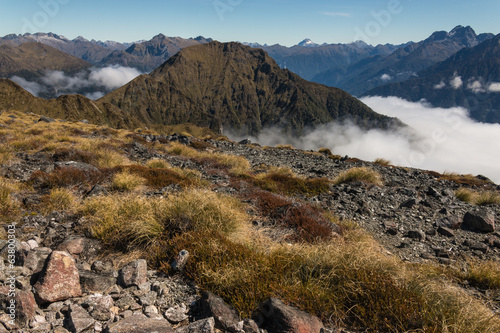 mountain peaks above inversion in Fiordland National Park