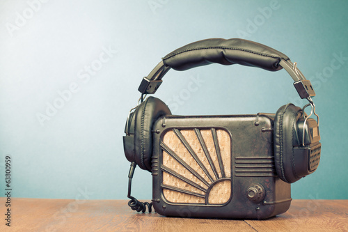 Retro radio and headphones on table