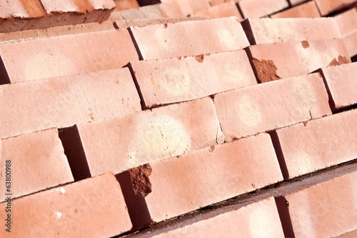 Stack of red clay bricks isolated background, XXXL