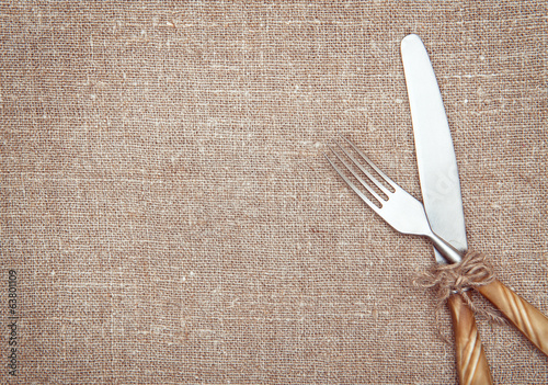 Fork and knife on the burlap