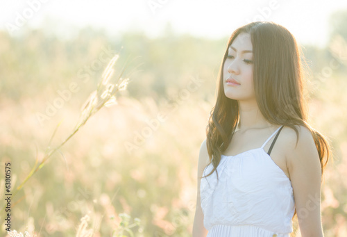 Pretty girl in a spring  flower garden 5