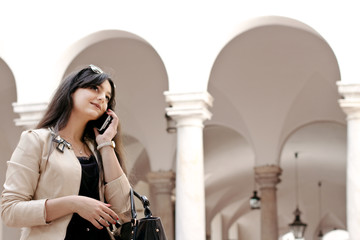 university student at the phone against historical architecture