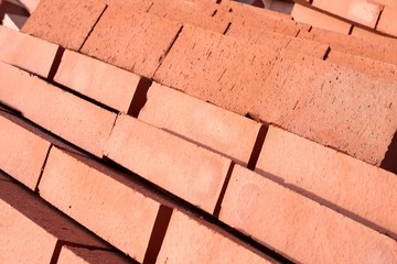 Stack of red bricks, used for building construction, XXXL