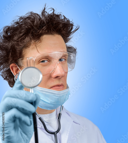 Funny doctor listens with stethoscope