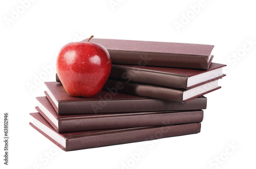 Book with apple isolated on white