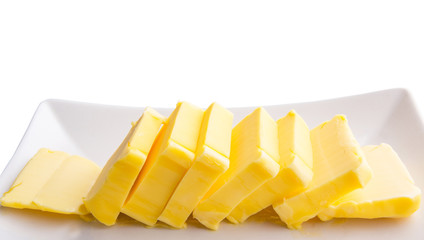 Fresh butter slices in a row