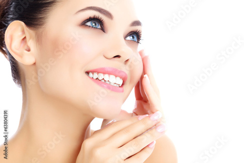 Cheerful female with fresh clear skin, white background.