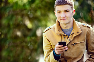 Attractive young man using a mobile phone