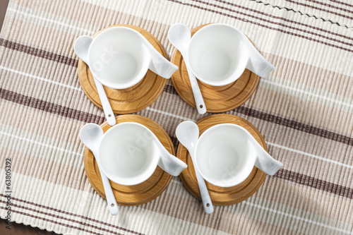 coffee cups on place mats
