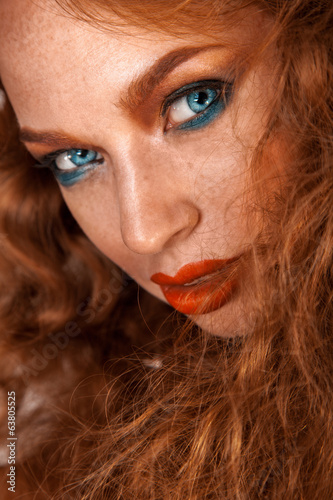 Attractive portrait of woman with freckles on skin and brown hai
