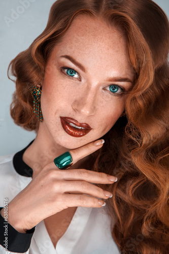 Charming fashion model with freckles in studio