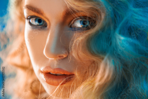 Charming portrait of woman with blue lights