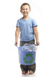 Cheerful boy holds a recycling bin full of plastic bottles