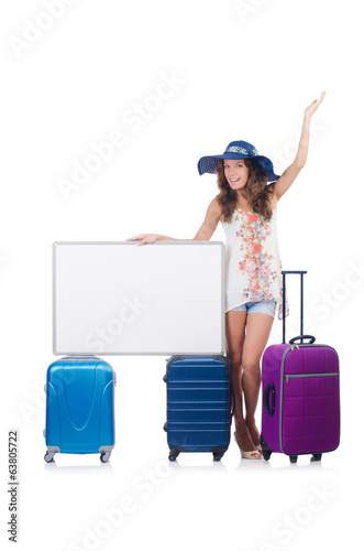 Woman in panama  preparing for vacation with suitcase and blank