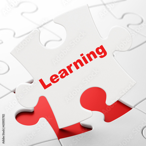 Education concept: Learning on puzzle background