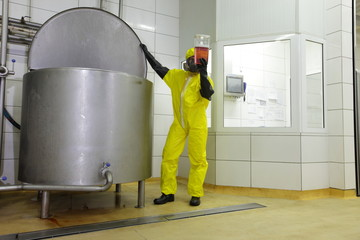 checking sample at large industrial tank in plant