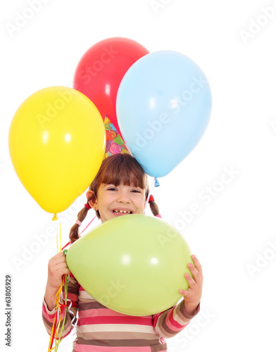 happy little girl with colorful balloons birthday party