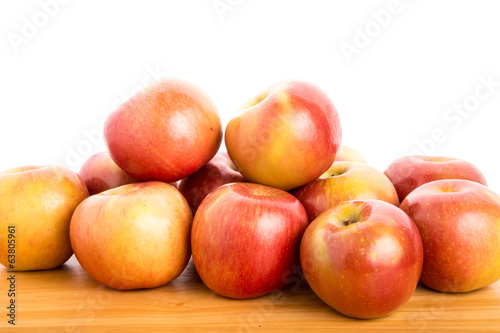 Fresh Red Apples on a Wood Table with White Background