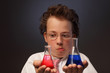 Funny emotional chemist with two flasks