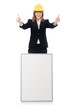Pretty businesswoman with hard hat and  blank board  isolated on