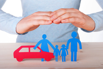 Hands Guarding Family and Car