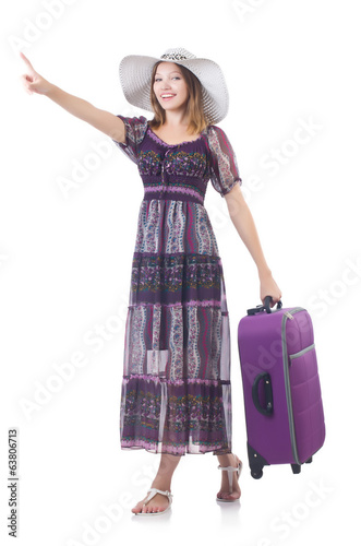 Woman in panama  with suitcase preparing for travel pressing vir