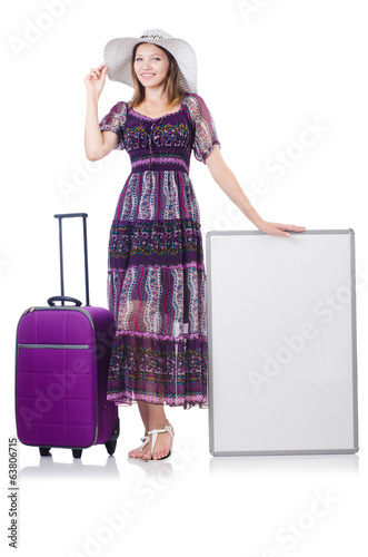 Woman in panama  preparing for travel  with suitcases and blankb