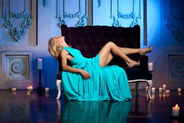 Beautiful woman like a princess in the palace. Luxurious rich fa