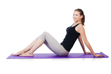 Young sporty woman doing exercises isolated on white