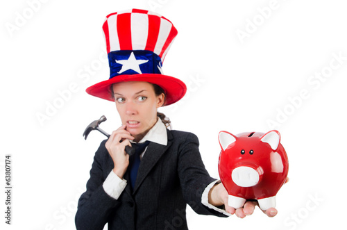 Businesswoman with piggy bank  and hammer  isolated on white