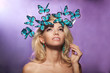 Luxury young girl with butterflies on her head. Beautiful stylis