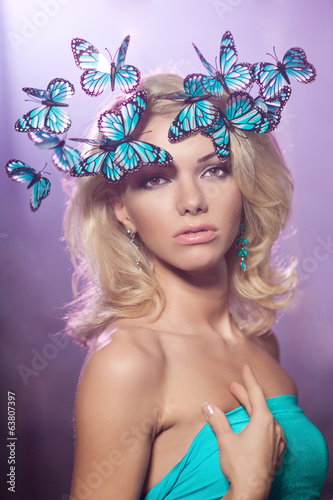 Luxury young woman with butterflies on her head. Beautiful styli