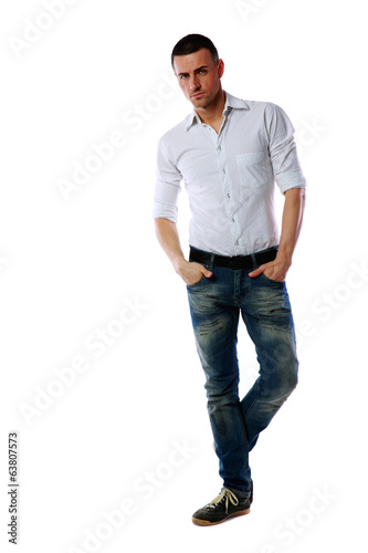 Full-length portrait of a confident man over white background
