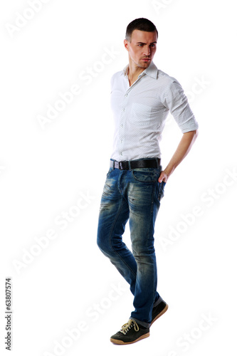 Full-length portrait of a pensive man over white background