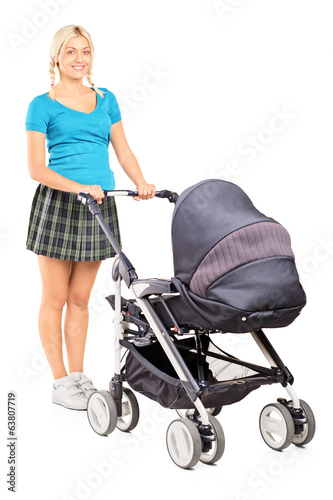 Young woman pushing a baby stroller