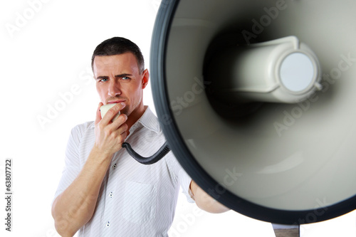 Portrait of a man roaring loudly into megaphone
